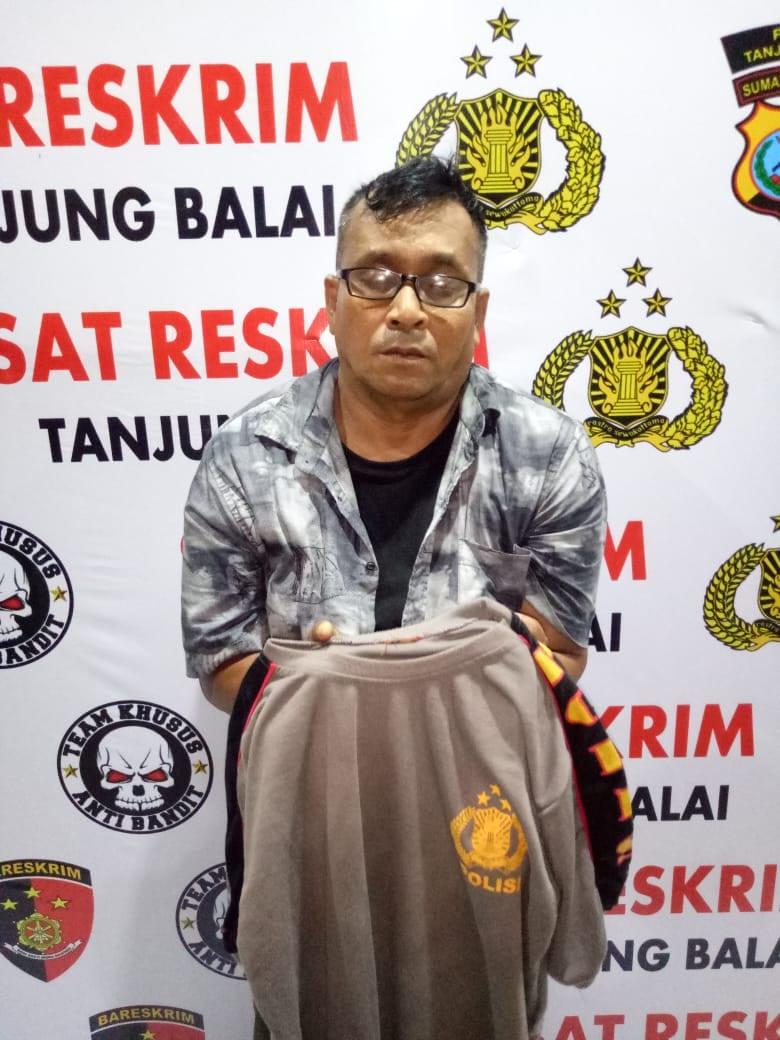 (Ignatius Siagian/taslabnews) Tersangka Surya Dharma Panjaitan alias Surya saat diamankan personil Tekab Sat Reskrim Polres Tanjungbalai