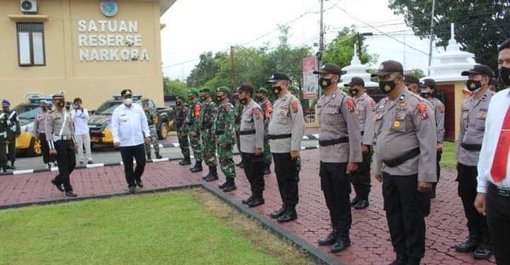 Pj Bupati Labuhanbatu Mulyadi Simatupang, S.Pi, M.Si, memimpin Apel di Polres Labuhanbatu.